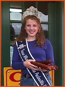 2001 Miss Teen Andouille presents sticks of Andouille