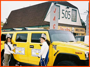 Miss Andouille and Miss Teen Andouille tour around in a 2003 Hummer H2 provided by Brian's Towing